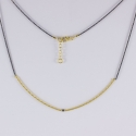 Collier tubulaire dorée et diamant noir